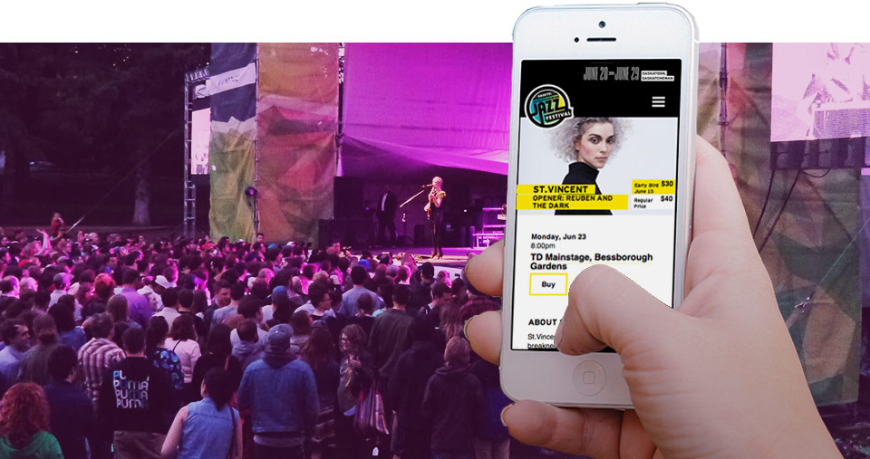 St. Vincent performing with a view of the mobile site